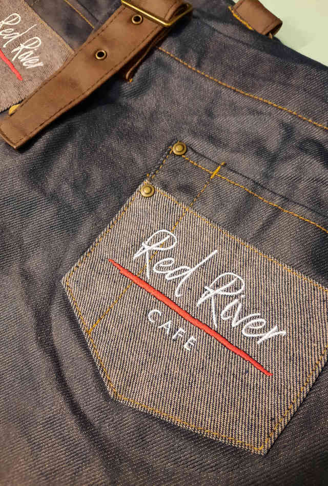 Screentech Design used a Tajima four-head embroidery machine to create the Red River Cafe logo