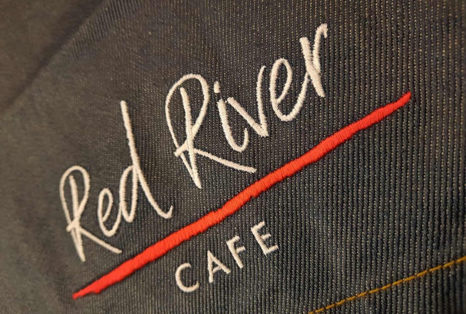 Embroidered denim aprons for Red River Cafe by Screentech Design