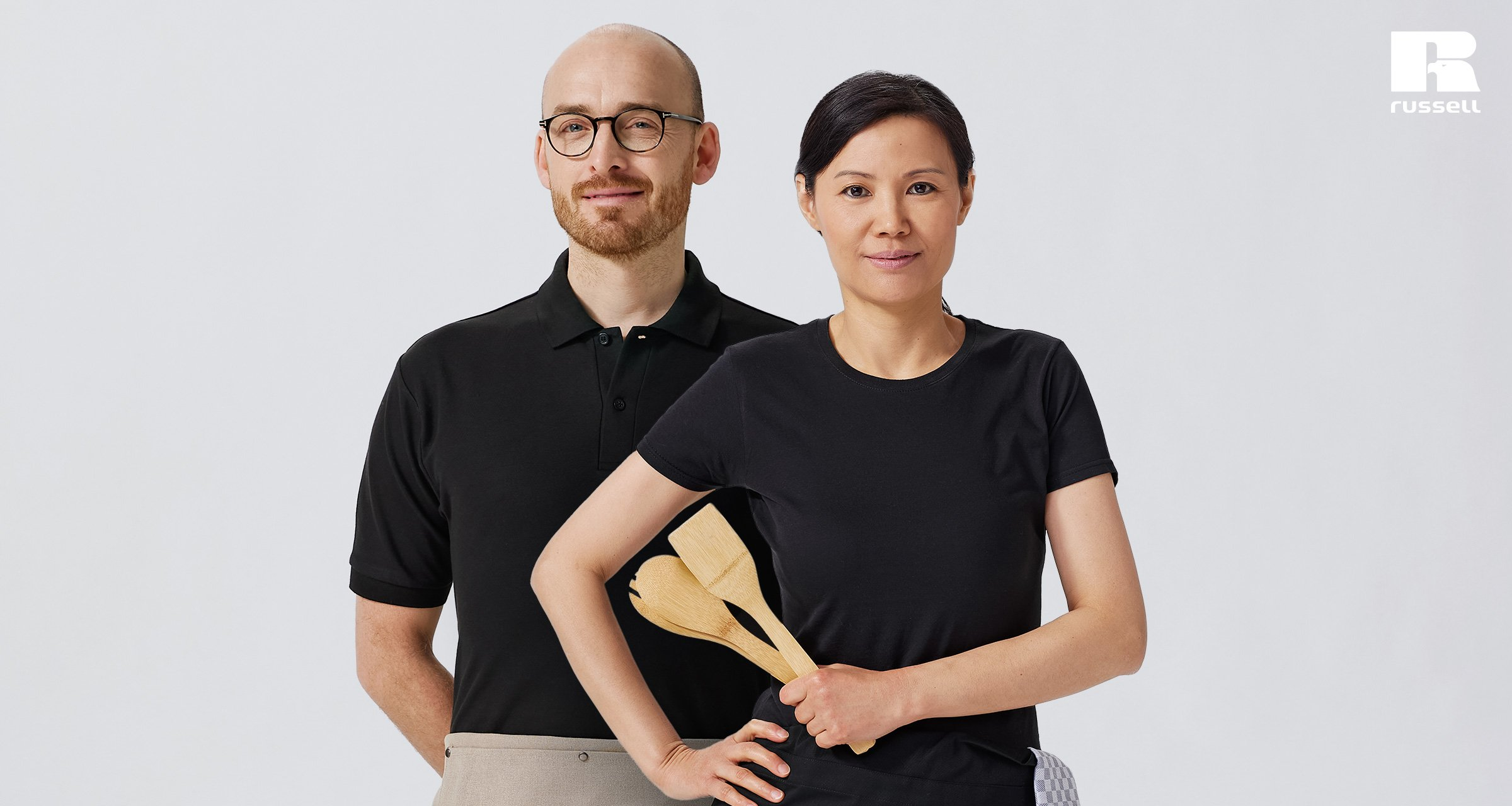 Man wearing Russell 539 Classic polo shirt and woman wearing Russell 155 slim fit T-shirt